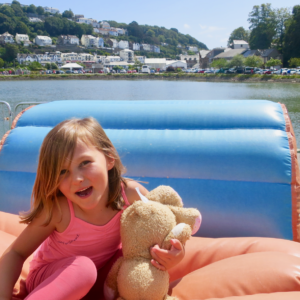 A bouncy castle with a view of Looe.